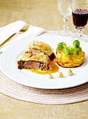 Pastilla-style fillet of beef stuffed with dried fruit ,mini potato gratin