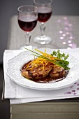 Pan-fried foie gras in chocolate sauce with orange zests