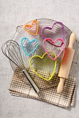 Multicolored heart-shape biscuit cutters,whisk and rolling pin