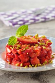 Strawberry tartare with crushed pistachios