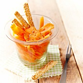 Carrot salad with herbs and breadsticks