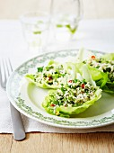 Flaked crab meat salad with herbs and chili pepper served in lettuce leaves