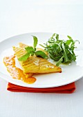 Grilled polenta and parmesan galette with red pepper puree