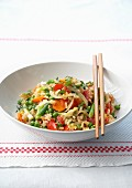 Sauteed rice with red peppers, carrots and peas