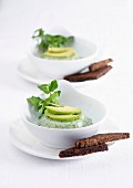 Small watercress panna cotta, thinly sliced avocado and black bread