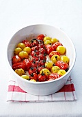 Yellow and red stewed cherry tomatoes with thyme
