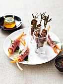 Beef duo :mini beef brochettes and raw beef and vegetable rolls