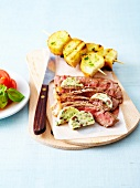 Grilled Irish sirloin ,anchovy butter and potato brochettes
