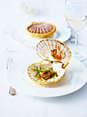 Asian-flavored scallops sealed with pastry served in their shells