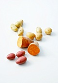 Potatoes and sweet potatoes on a white background