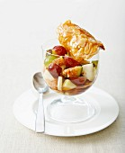 Autumn fruit salad with caramelized almond tuiles