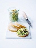 Zucchini and crushed pistachios on sliced bread