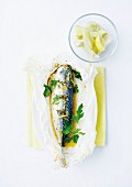 Mackerel with lemon cooked in wax paper and artichoke heart salad