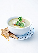 Cream soup of white asparagus and grilled bacon