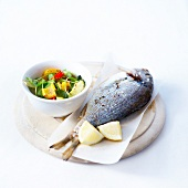 Sea bream oven-baked with sea salt and a small crsipy salad