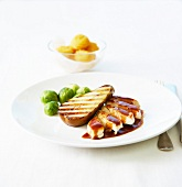 Turkey breast in English sauce, grilled pear and Brussles sprouts
