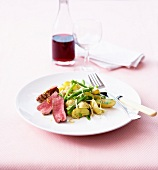 Grilled lamb noisette fillet with potatoes, spring onions and green beans