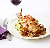 Rabbit with mushrooms and raw ham,herby mashed potatoes