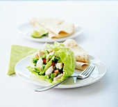 Mixed chicken salad in a lettuce leaf