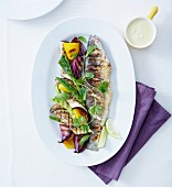 Grilled bass with lime,fresh herbs,eggplant,pepper and grilled onions