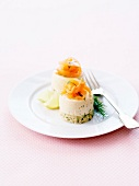 Salmon and dill mousse timbals on a bed of semolina