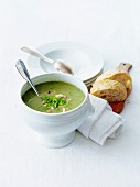 Creamed watercress soup with herbs and chopped mushrooms