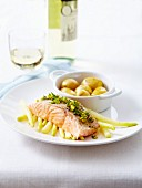 Piece of salmon topped with lemon and dill,white asparagus