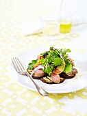 Thinly sliced grilled eggplants with veal fillet and sprouts