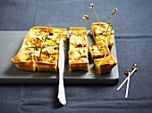 Curry-flavored vegetable and almond quiche to share at an aperitif