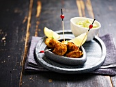 Fish croquettes with cream of avocado