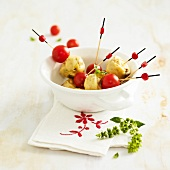 Goat's cheese-zucchini mini cake and cherry tomato brochettes