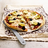 Artichoke, olive and mozzarella pizza