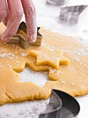 Cutting out stars in the cookie dough with a biscuit cutter