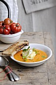 Cold tomato soup with fromage frais raviolis and