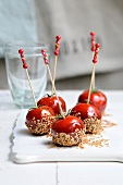 Toffee apple-style tomato and sesame seed cocktail bites