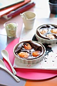 Small chocolate and apricot batter puddings