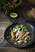 Spinach, duck and peanut salad