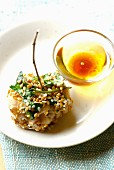 Fishball coated in white and golden sesame seeds and cilantro