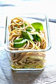 Soba noodle and spinach salad with sesame seed oil