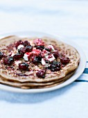 Chestnut flour pancakes, sheep's milk cheese and griotte sour cherries