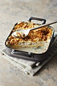 Cod and Camembert lasagnes topped with pine nut crumble