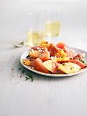 Melon, watermelon, raw ham and crumbled feta salad