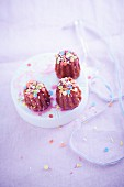 Vanilla cupcake-style Cannelés with raspberry