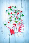Christmas garlands and the word Noel written in wooden letters