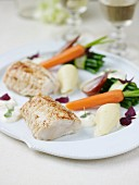 Roasted monkfish tail with spring vegetables ,white butter sauce