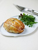 Young duck in flaky pastry crust