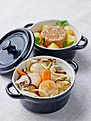 Scallop,fennel and mushroom casserole,stewed lamb and steamed potato casserole with tomato sauce