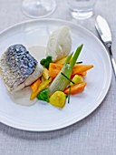 Pan-fried bass fillet with mariniere sauce,autumn vegetables