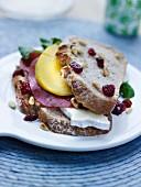 brie de Meaux,mango,bresaola,cranberry and pine nut sandwich
