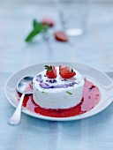Cream cheese mousse with strawberry coulis